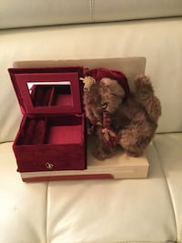 Brown bear plush toy and red jewelry box with mirror. Vancouver, V6G 1H2