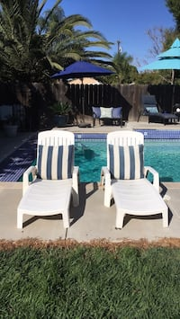 Two white resin lounge chairs with pillows, for $40.Both chairs have adjustable backs. Manteca, 95337
