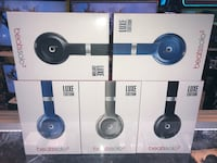 Black, blue, and gray beats by dr. dre wireless headphones boxes