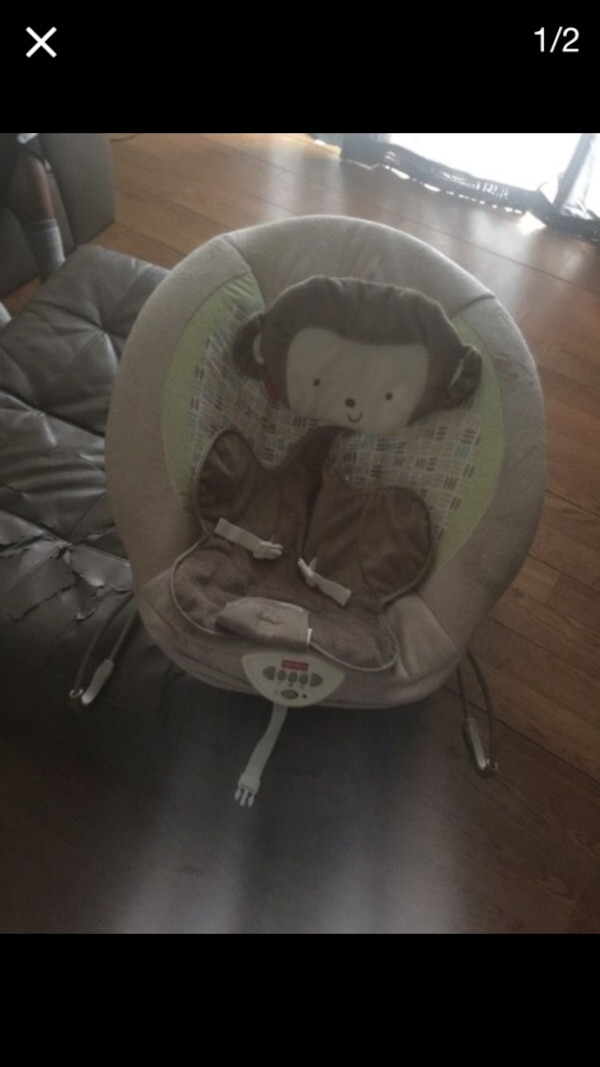 baby's brown Fisher-Price bouncer vibrates and makes music
