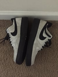 pair of white-and-black Nike sneakers 31 mi