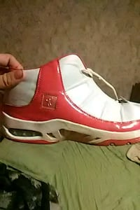 Pair of red and white basketball shoes