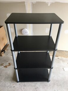 black and gray wooden 4-tier rack