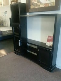 black wooden TV hutch with flat screen television Pharr, 78577