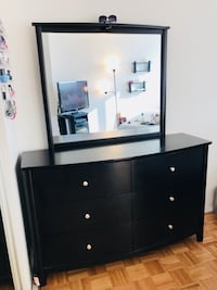 Black wooden dresser with mirror