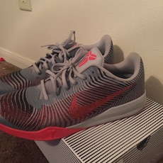 pair of grey-and-pink Kobe Bryant shoes