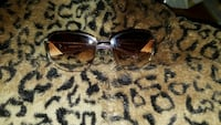 brown tinted sunglasses with black frame 1299 km
