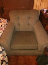 brown fabric sofa chair with throw pillow 26 mi