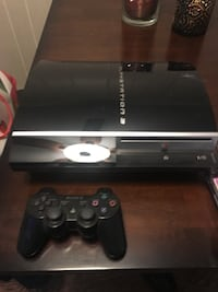 black Sony PS3 Slim with two controllers Rehoboth Beach, 19971