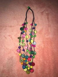 green, red, and blue beaded necklace
