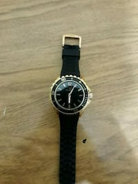 round silver analog watch with black strap