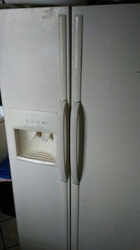 white side-by-side refrigerator with dispenser