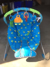 Bright Stars baby's blue bouncer. Vibrates and plays music.  Has 4 detachable toys.