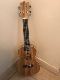 Brown and black 4-string classical guitar Spring, 77380