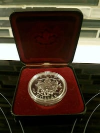 round silver coin in box Toronto, M6J 1J1