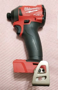 red and black Milwaukee cordless impact wrench Arlington, 22204