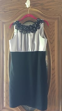 This is a black dress size 10 never worn Clay, 48001