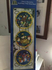Three piece Christmas plates on metal rack Hialeah, 33015