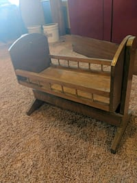 Wooden doll cradle