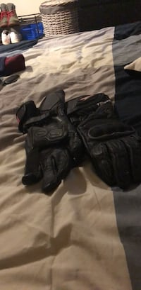 pair of black leather gloves Vancouver, V5W 3H3