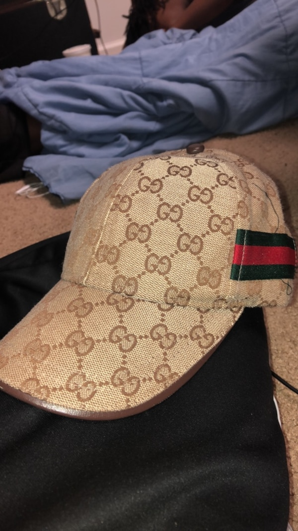 6eae4ca415adf Used brown and black Gucci monogram cap for sale in Kennesaw - letgo