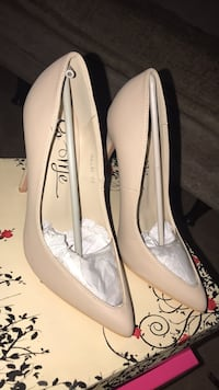 pair of white leather flats Manassas