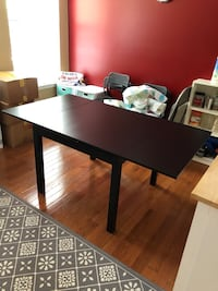 Black wooden table with black metal base
