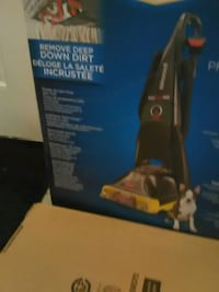 black and blue Bissell upright vacuum cleaner box Abbotsford, V4X 1L9
