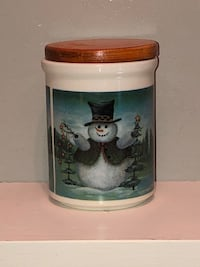 Small ceramic cookie jar with wood lid. Located Millwoods/south side Edmonton, T6L 6P5