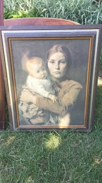 Woman in white dress painting with brown wooden frame Toronto, M8W 4K2