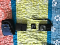 black Canon point-and-shoot camera with battery charger and pouch Palatine, 60074
