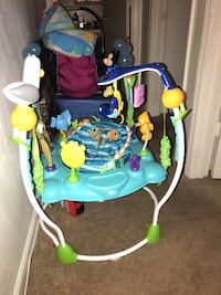 Baby's blue,green, and yellow jumperoo