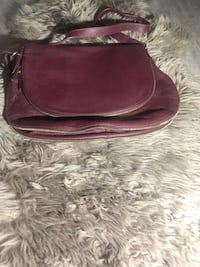 Daniel leather bag ( never used )  Coquitlam, V3B 0M8