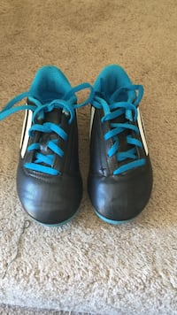 Pair of blue-and-black Adidas cleats size is 13k