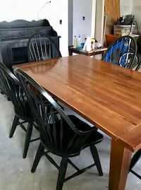 Rectangular oak dining table with black oak chairs set