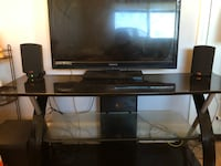 flat screen TV and brown wooden TV stand Santa Ana, 92703