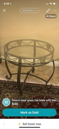 round clear glass top table with black metal base London, N6G 0B4