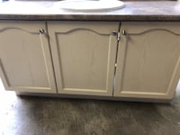 Vanity and sink.  Used in good condition.  See pics for dimensions Springwater, L9X