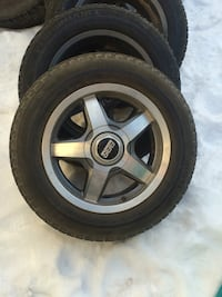 Gray 5-spoke vehicle wheel and tire 3119 km
