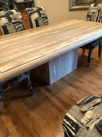 Table is 8'x3 1/2'. Price is for table only...chairs sold separately for $175 each...set of 6. If you Google travertine dining table you can compare what a bargain this is. Elkhorn, 68022