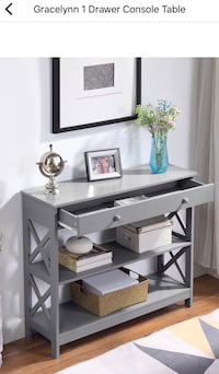 Gray console table. Brand new in box but it came a little chipped. Negotiable! Baltimore, 21230