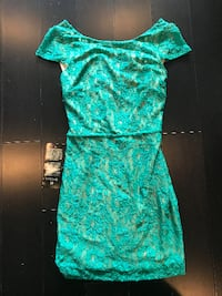 NWT Green lace with gold lining BeBe criss cross open back dress size XS