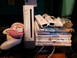 Wii w with fit board and 18 games