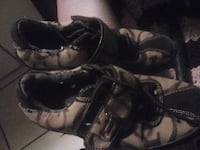 pair of black leather boots Edmonton, T5H 0N4