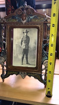 Heavy cast iron picture frame with an old post card Calgary, T2Y 2W5