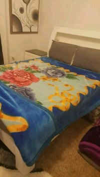 blue, yellow, and red floral bed sheet Calgary, T2A 4V5