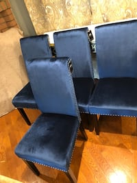Blue velvet Brand new dinning room chairs.  Brand new in box and never used.  More than 4 chairs available! Different colours but same style. Has a studded design. All chairs come brand new in box. Chair legs are solid wood and Expresso.   Dimensions: Bac Toronto, M9V 4T4