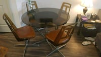 round glass top table with four chairs dining set Columbia, 21044
