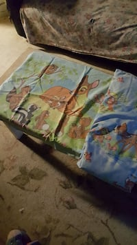 two blue and green Deer print textiles
