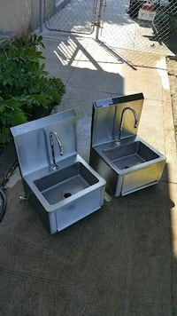two silver steel sinks with stainless steel faucet
